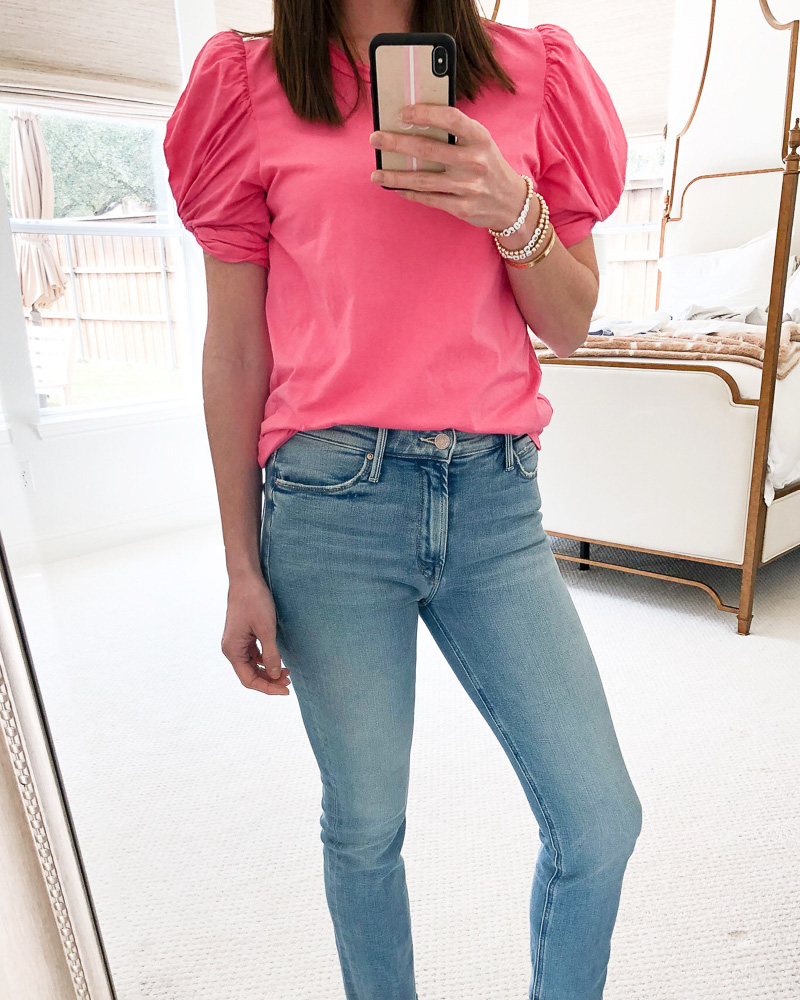 woman in pink puff sleeve top and jeans