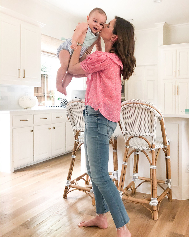 mom holding baby in kitchen