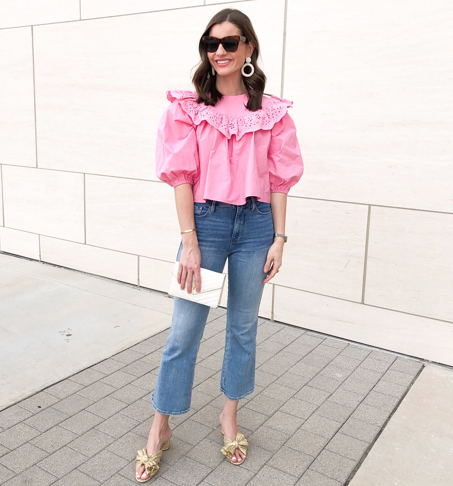 woman wearing pink ruffle top jeans gold bow sandals