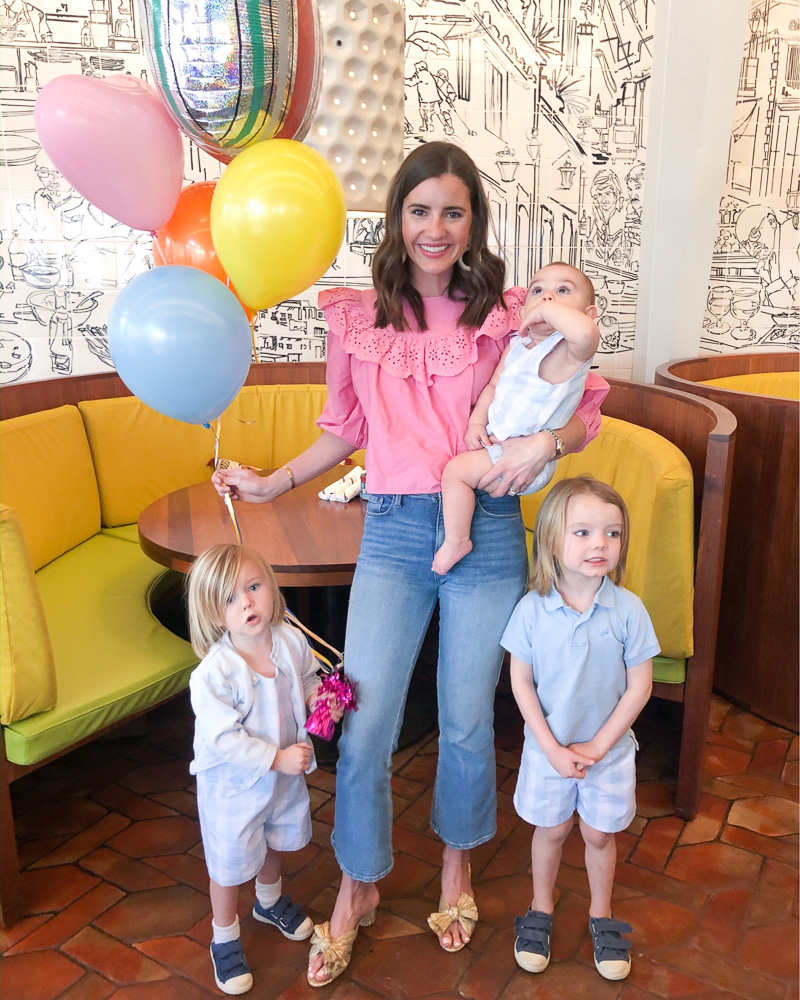 mom with three young boys and balloons