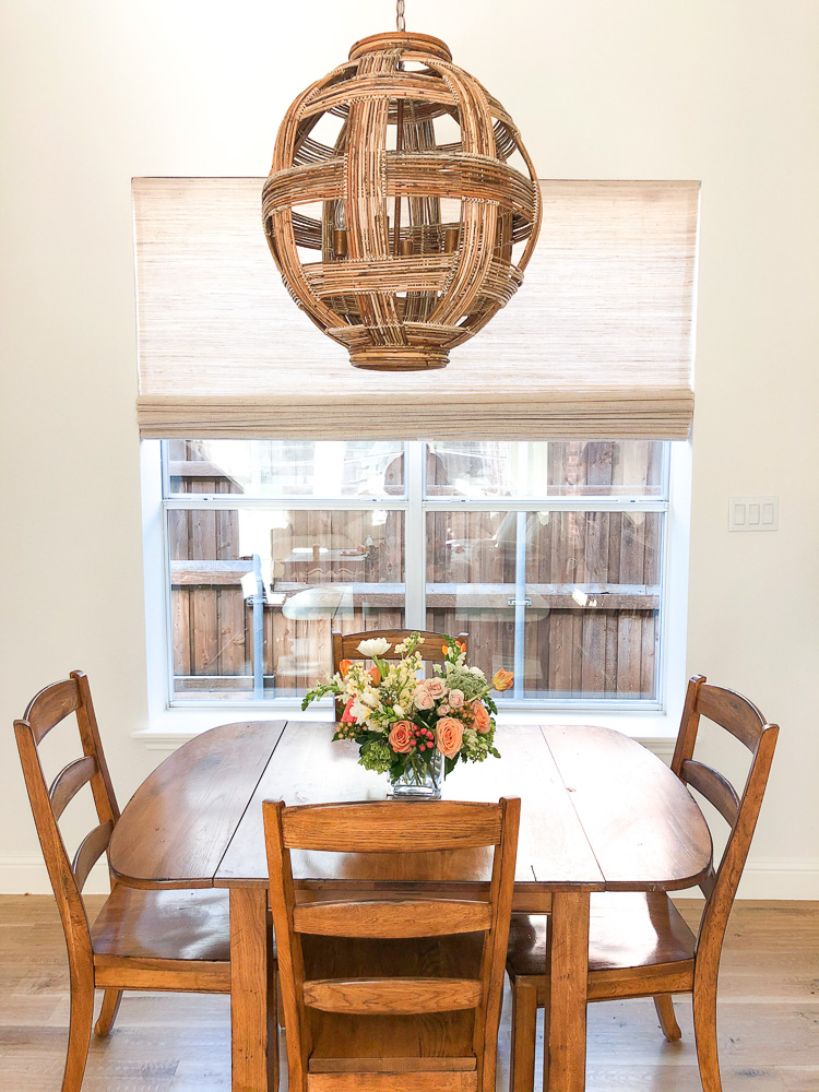 rattan light fixture over dining table