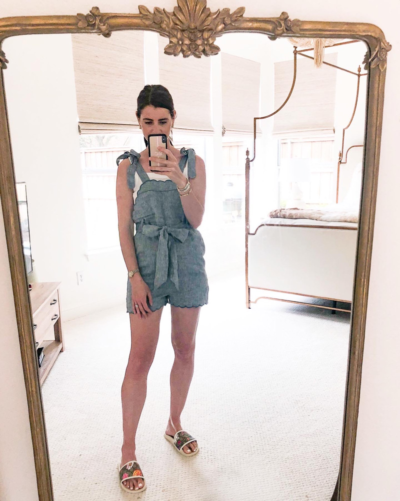 mirror picture of woman wearing chambray romper