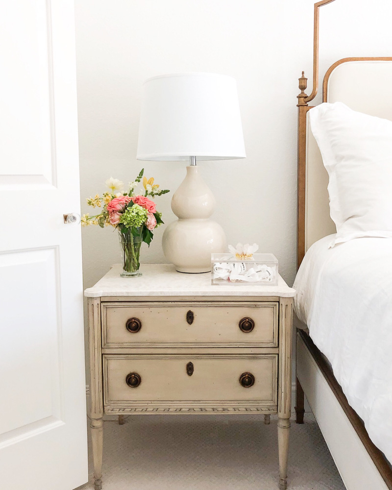 antiqued white nightstand