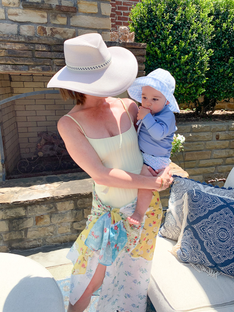 mom and baby in swim suits on patio