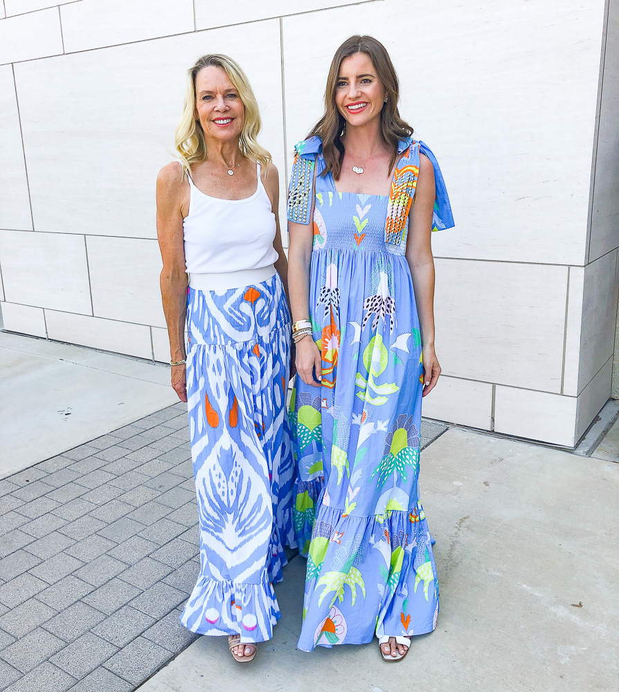 two women in floral maxi dresses