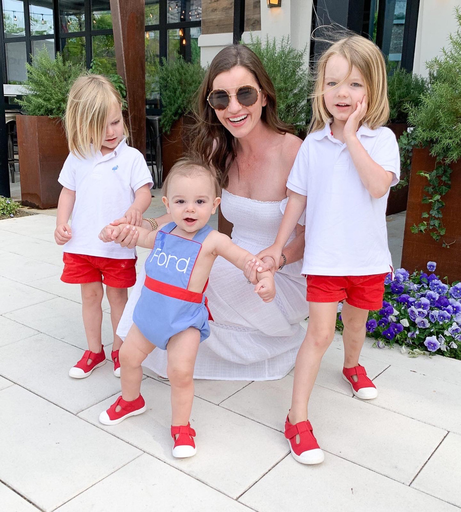 mom with three little boys in red white and blue outfits