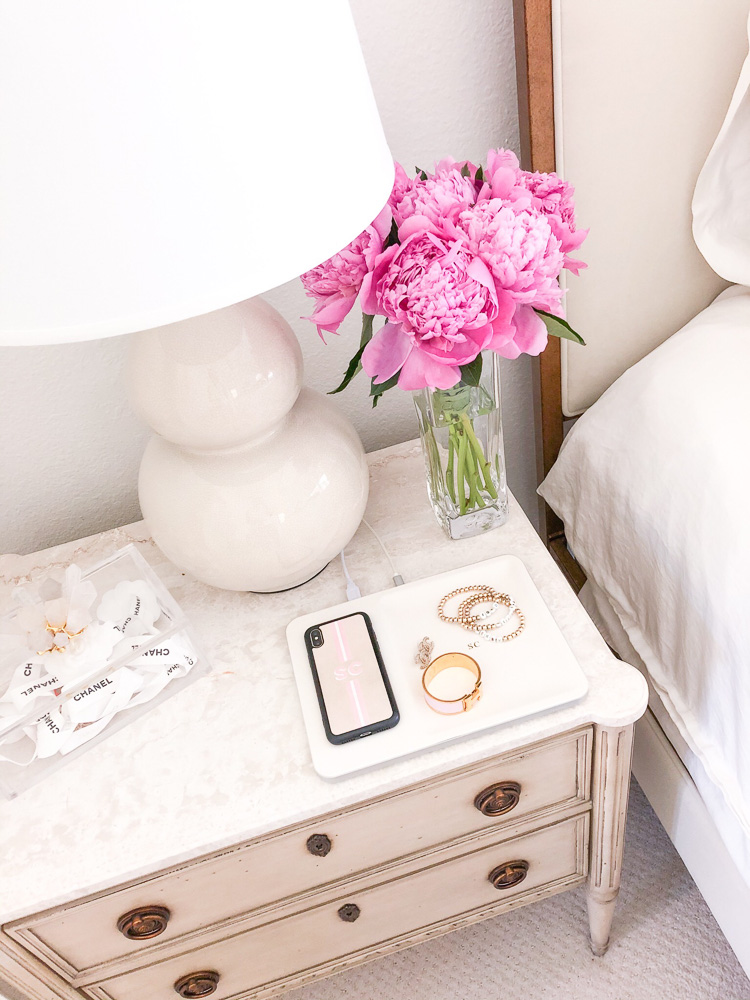 nightstand with white lamp pink flowers