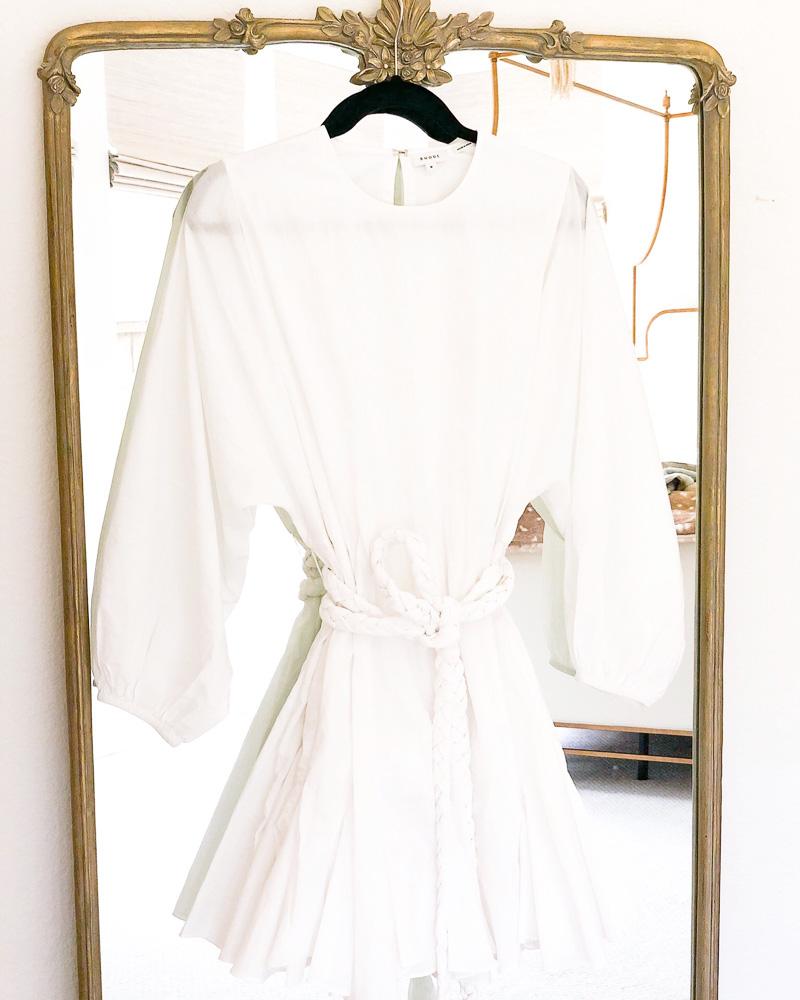 white tie waist dress hanging on mirror