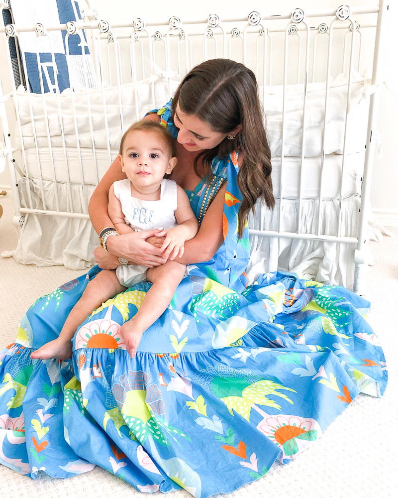 woman wearing tropical maxi dress holding baby