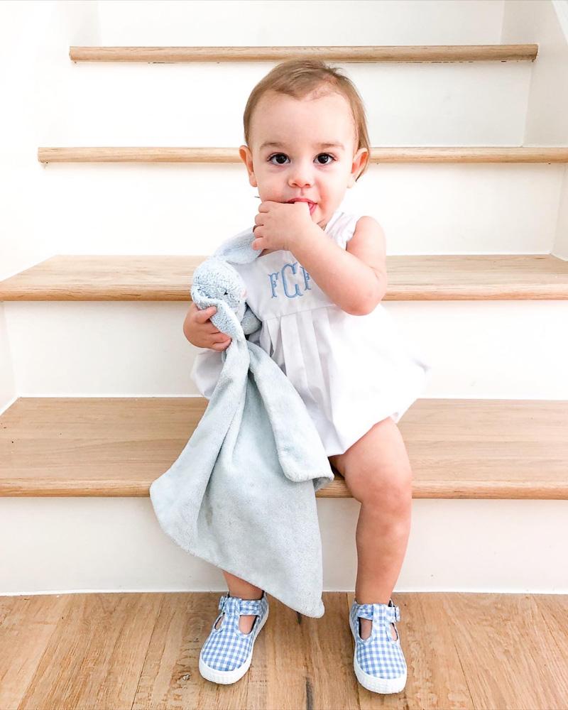 baby sucking thumb on stairs