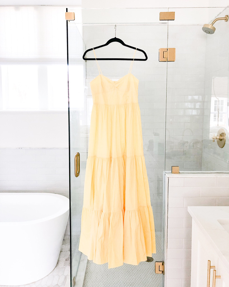 yellow maxi dress hanging on shower