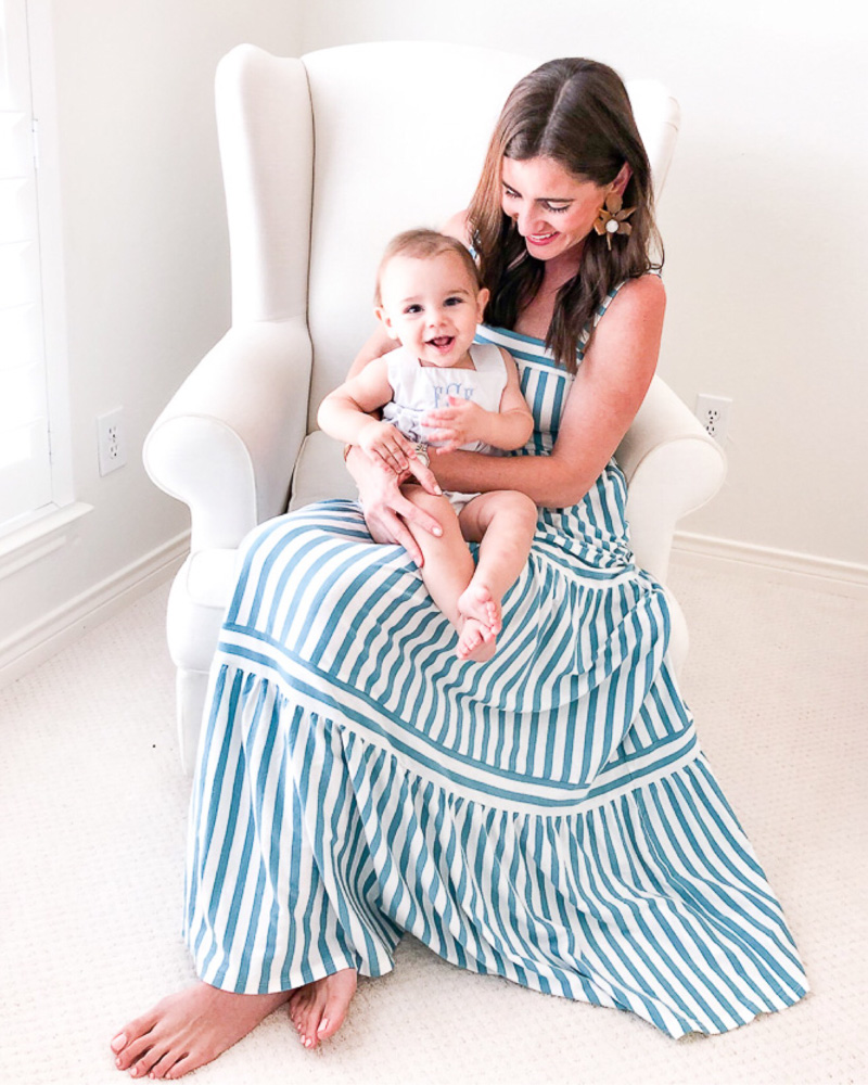 mom in striped maxi dress holding baby boy