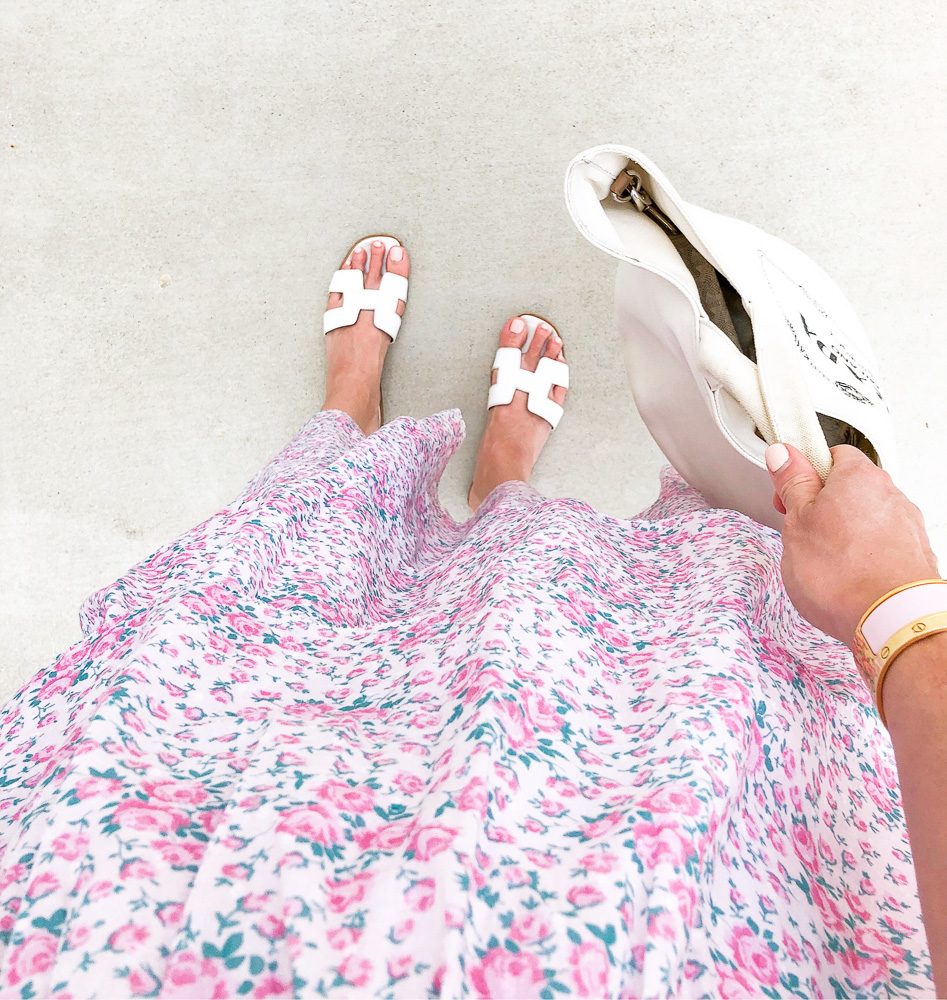 looking down on floral maxi and white sandals