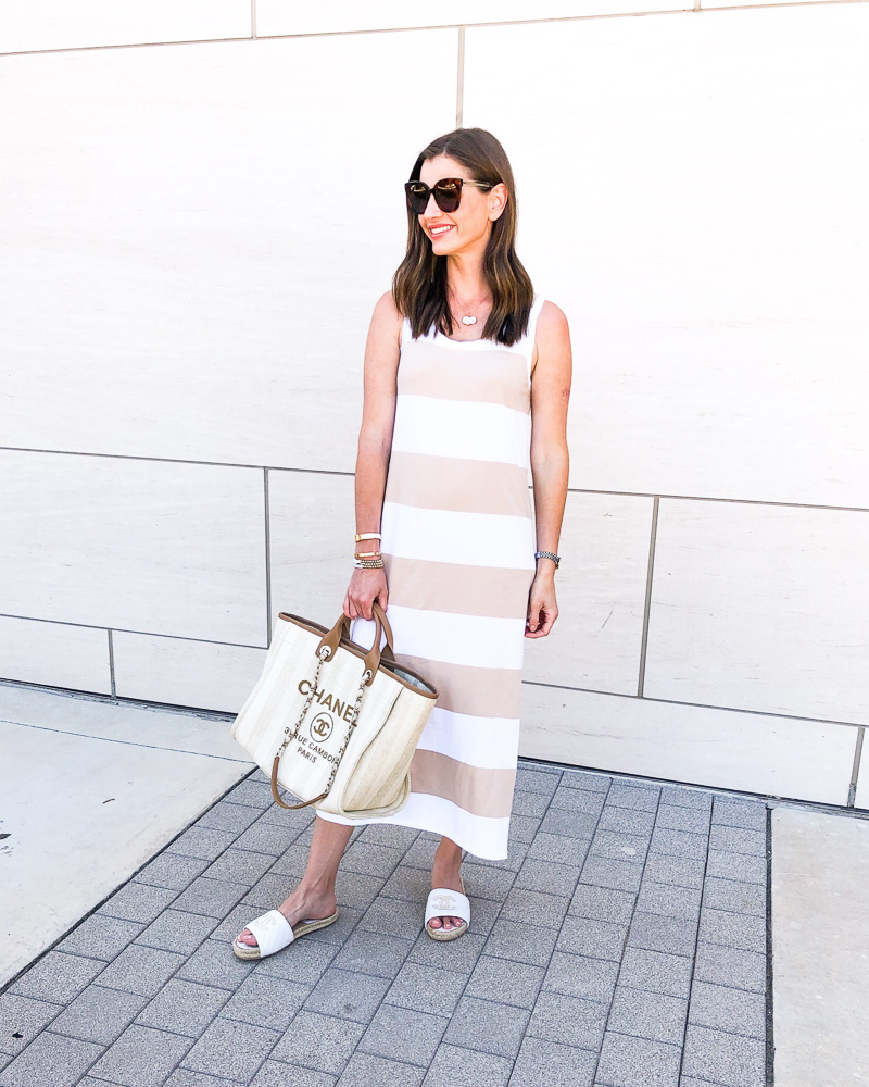 woman in tan and white striped maxi drewss and chanel tote