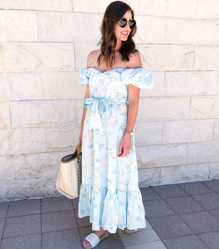 woman in baby blue floral maxi dress