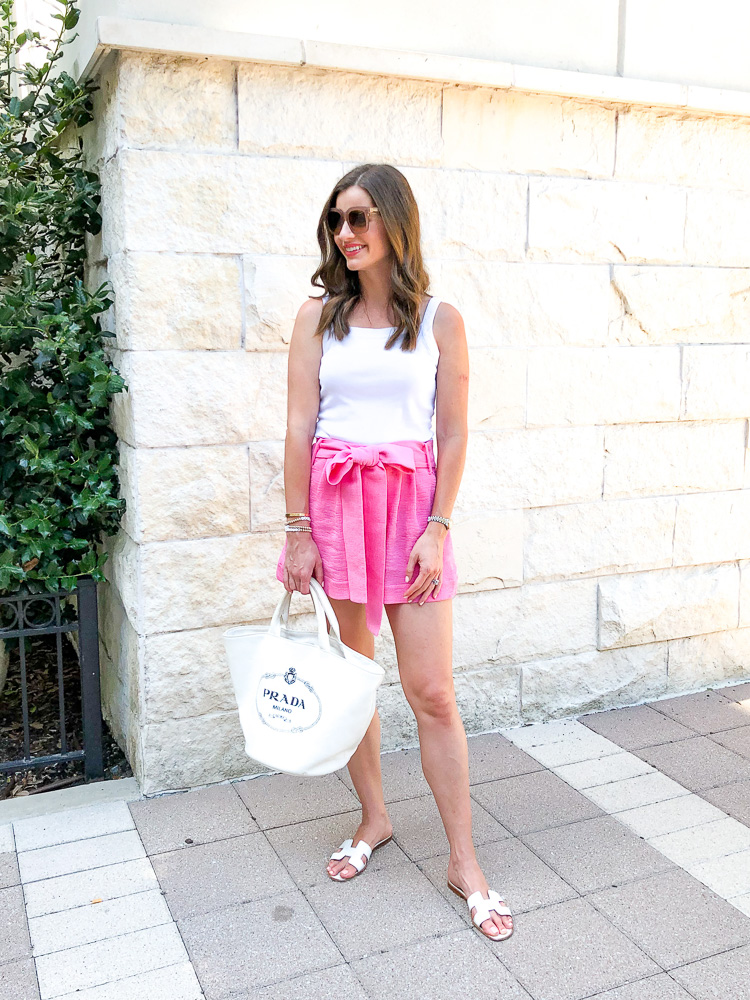 pink shorts with bow white tank top