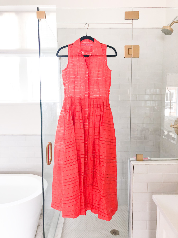 red maxi dress hanging on shower