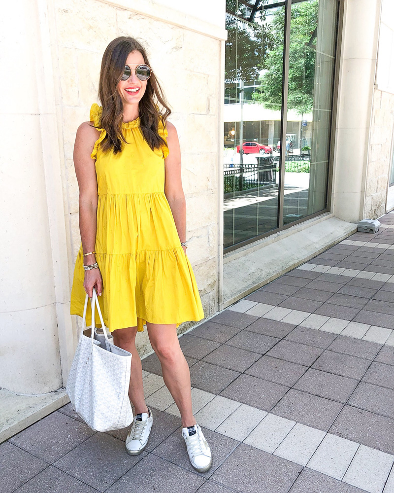 woman wearing yellow tiered and ruffle dress
