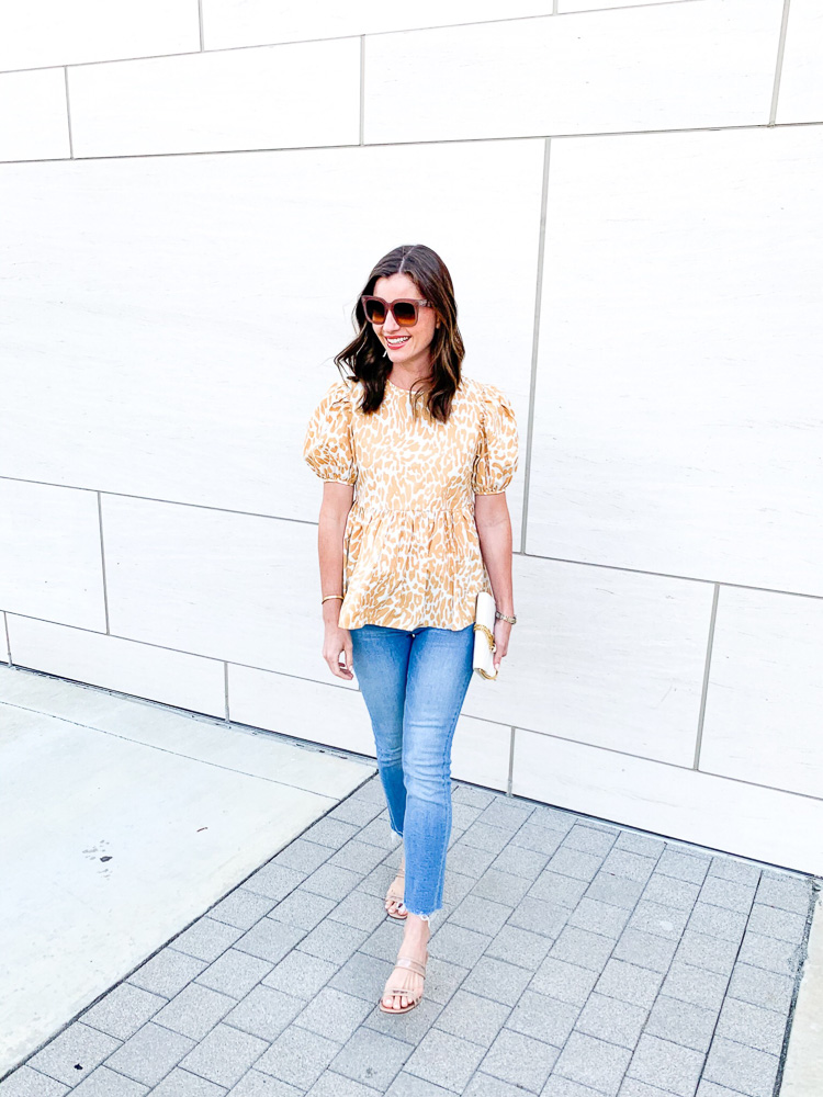 woman wearing yellow and white printed top
