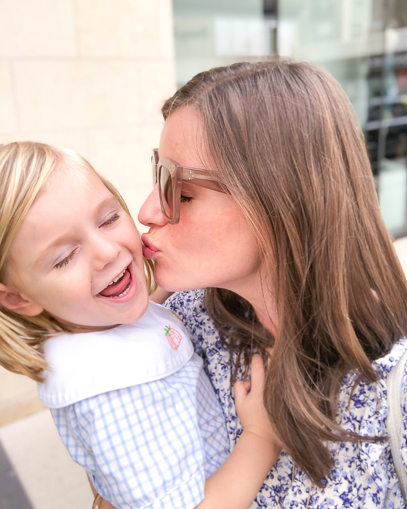mom kissing little boy