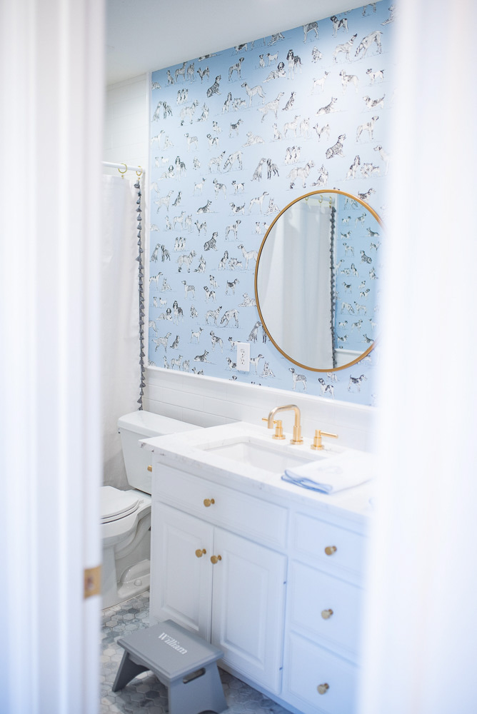 looking into a blue and white bathroom