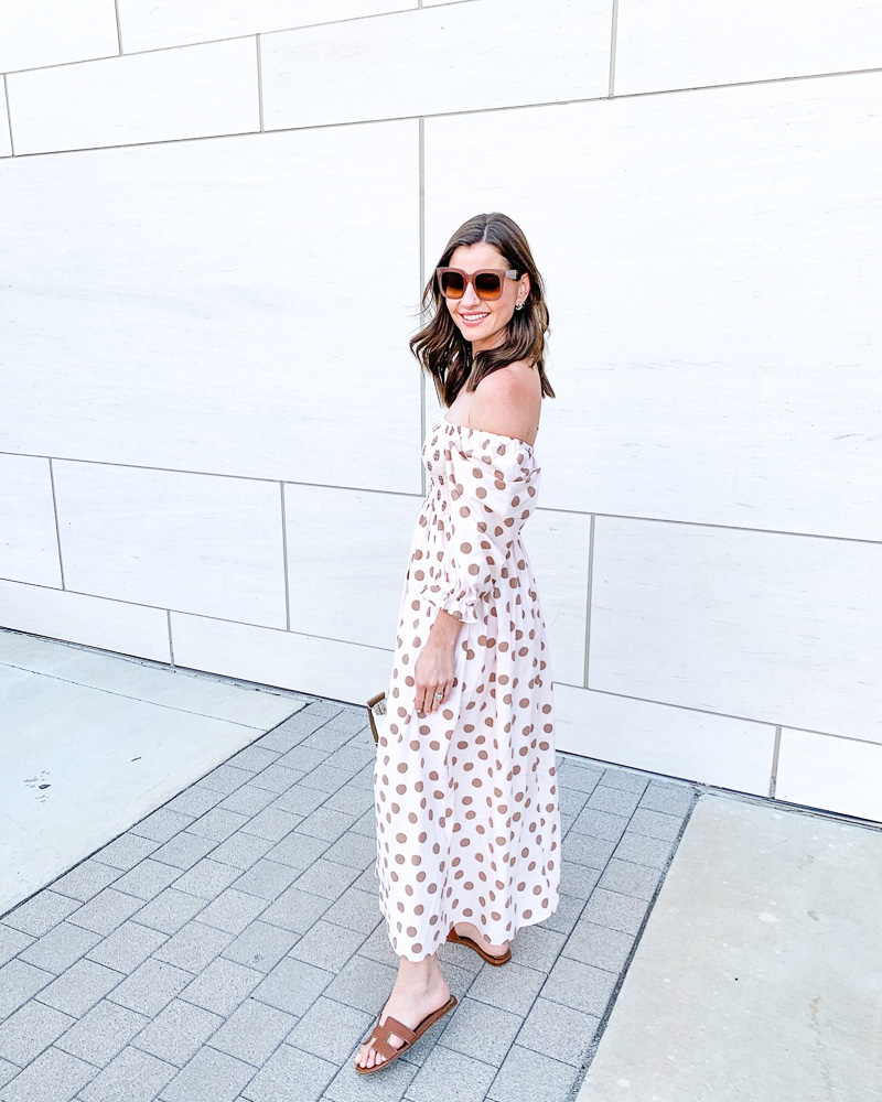 woman in off the shoulder polka dot maxi dress