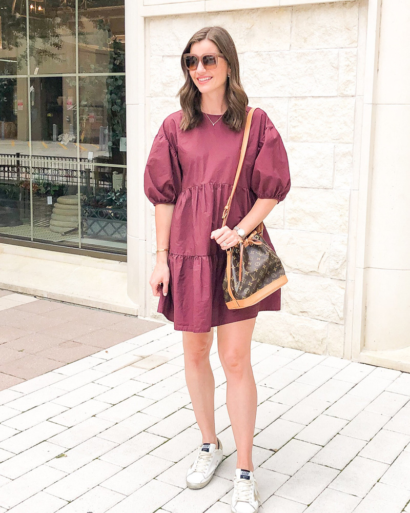 woman in burgundy tiered mini dress