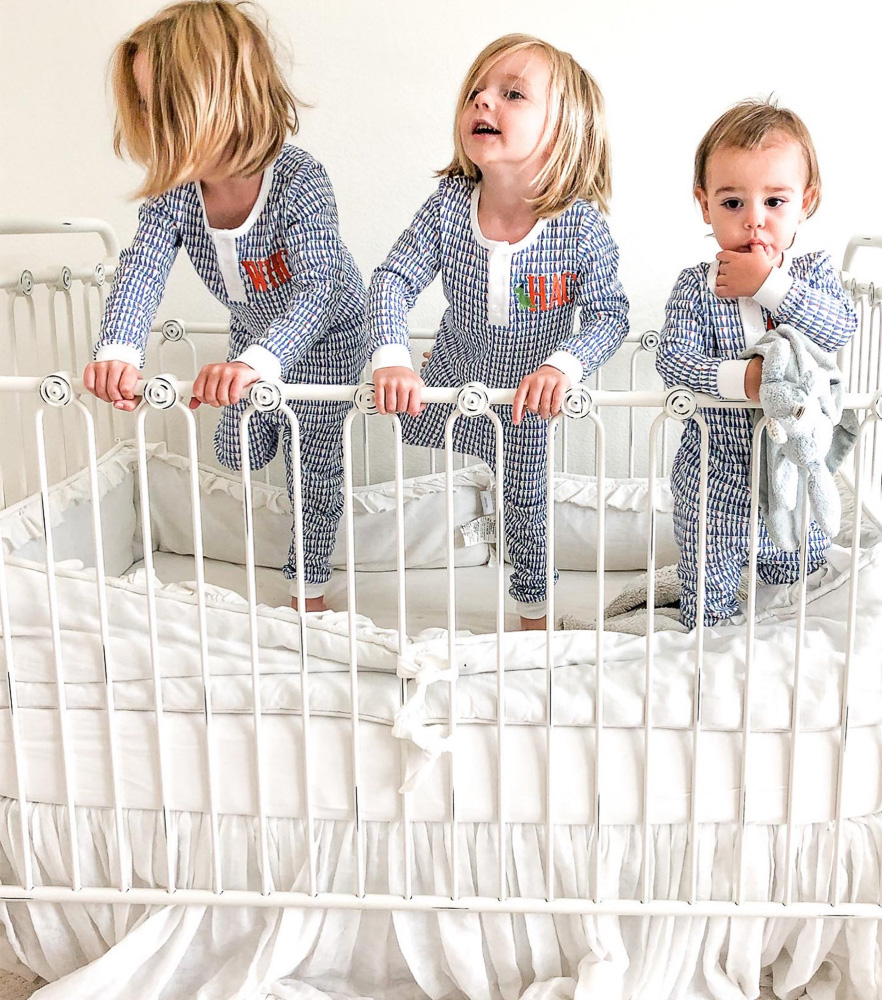 three brothers standing in crib