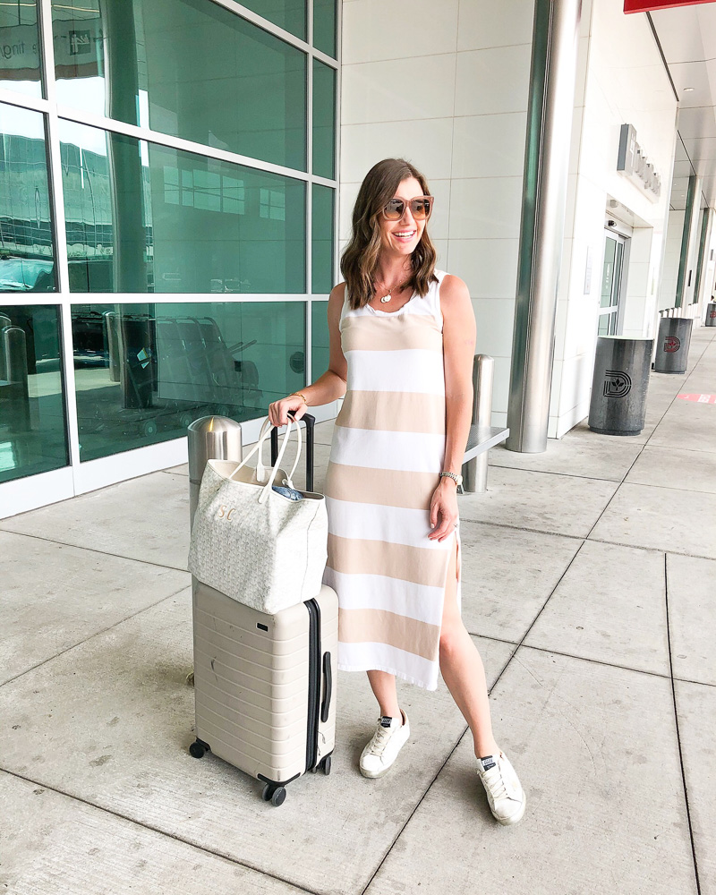 woman in striped midi dress at airport