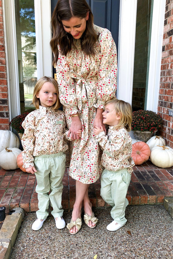 mom with young boys in matching outfits for thanksgiving