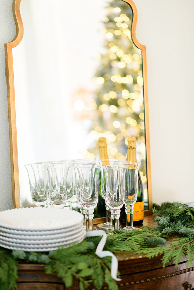 champagne and glasses in front of mirror