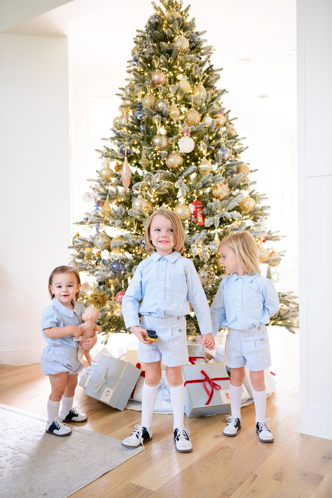 three young brothers in front of Christmas tree