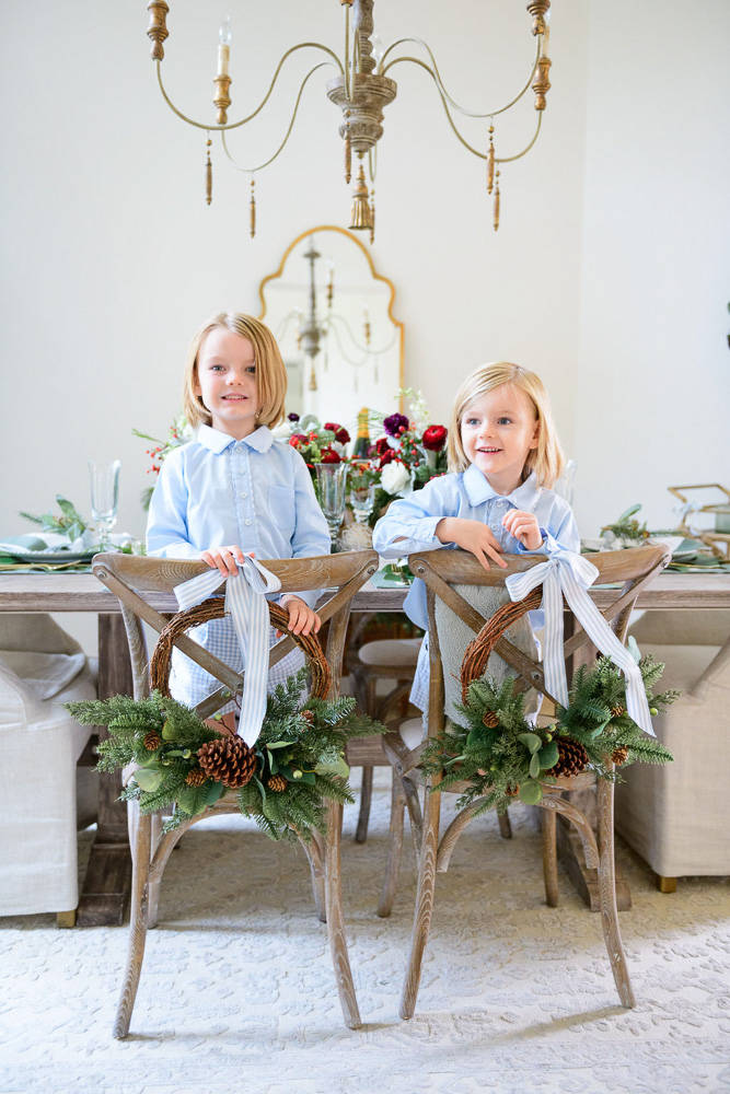 two young boys sitting backward on decorated chairs