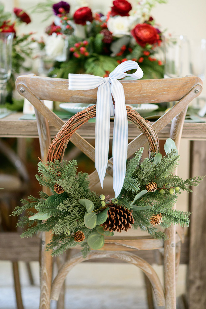 chairback wreath with blue ribbon