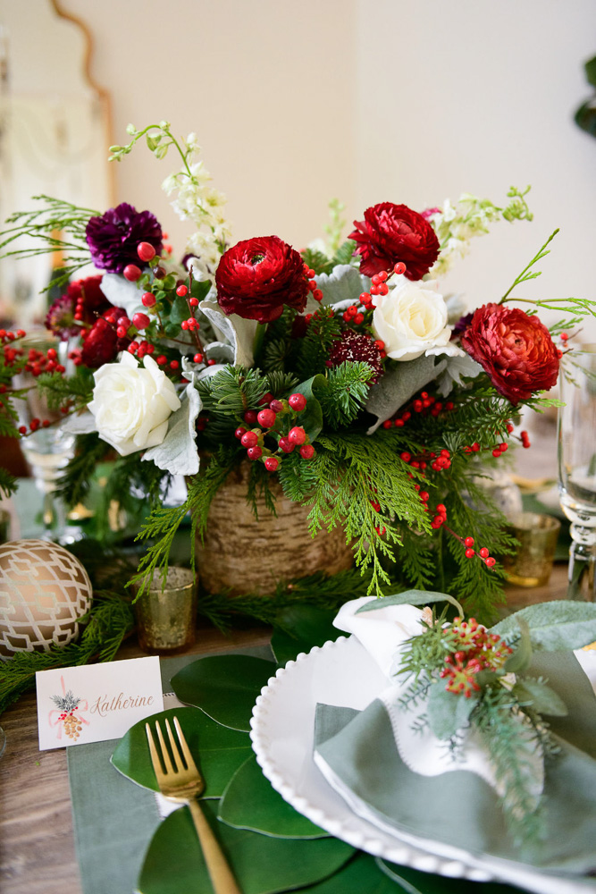 holiday table setting with floral centerpiece
