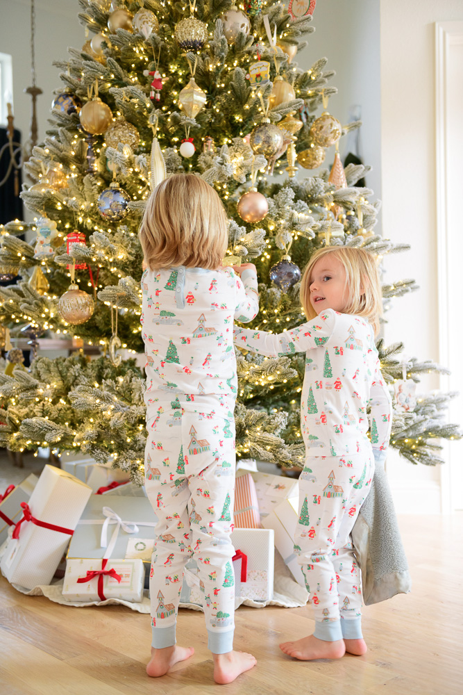 two brothers in matching christmas pajamas
