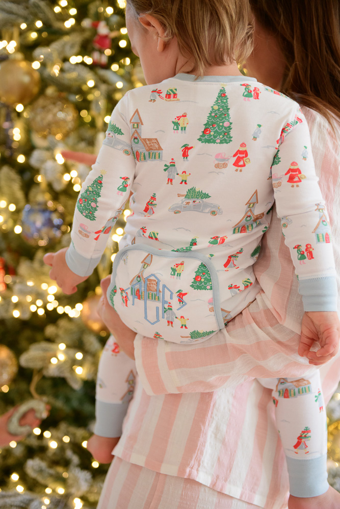 baby boy in christmas pajamas with monogram diaper flap