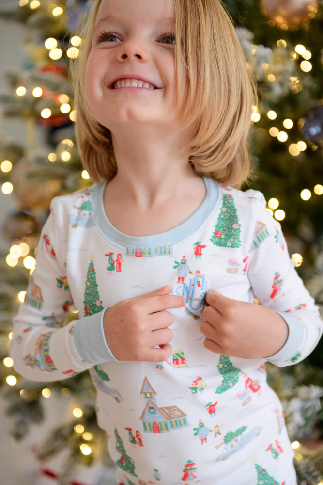 boy smiling wearing christmas pajamas