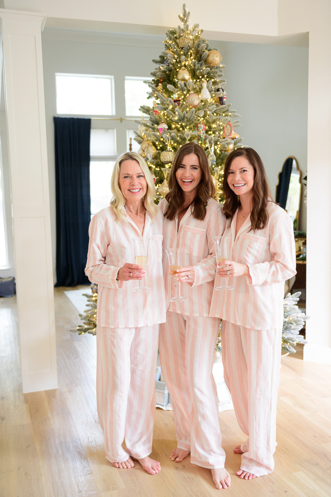 three women in matching pink striped pajamas