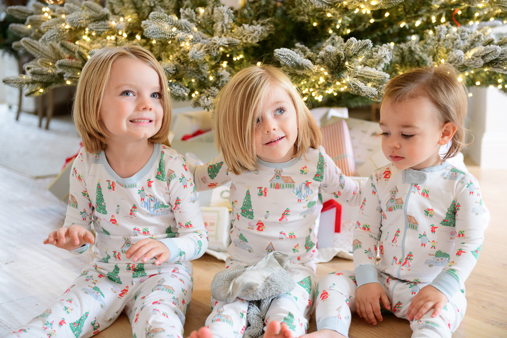 three toddler boys in front of christmas tree
