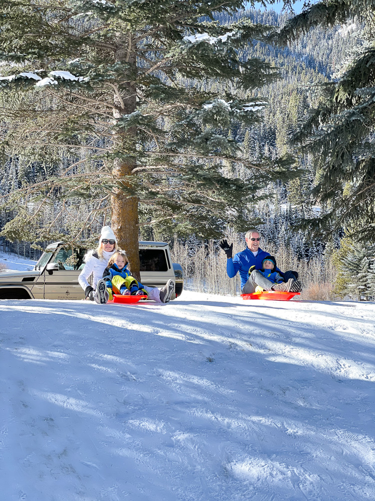 grandparents sledding with grandsons
