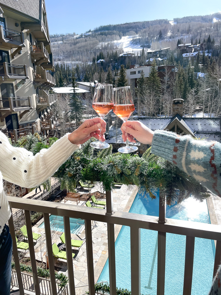 toasting on balcony at four seasons vail