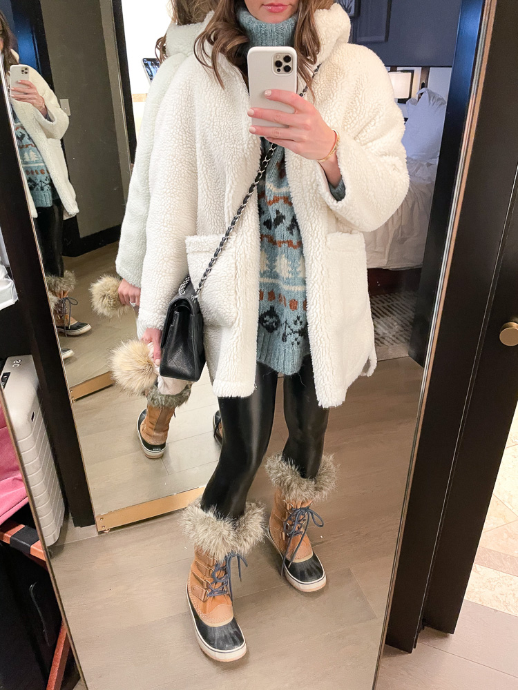 winter outfit with sherpa coat, sweater and snow boots