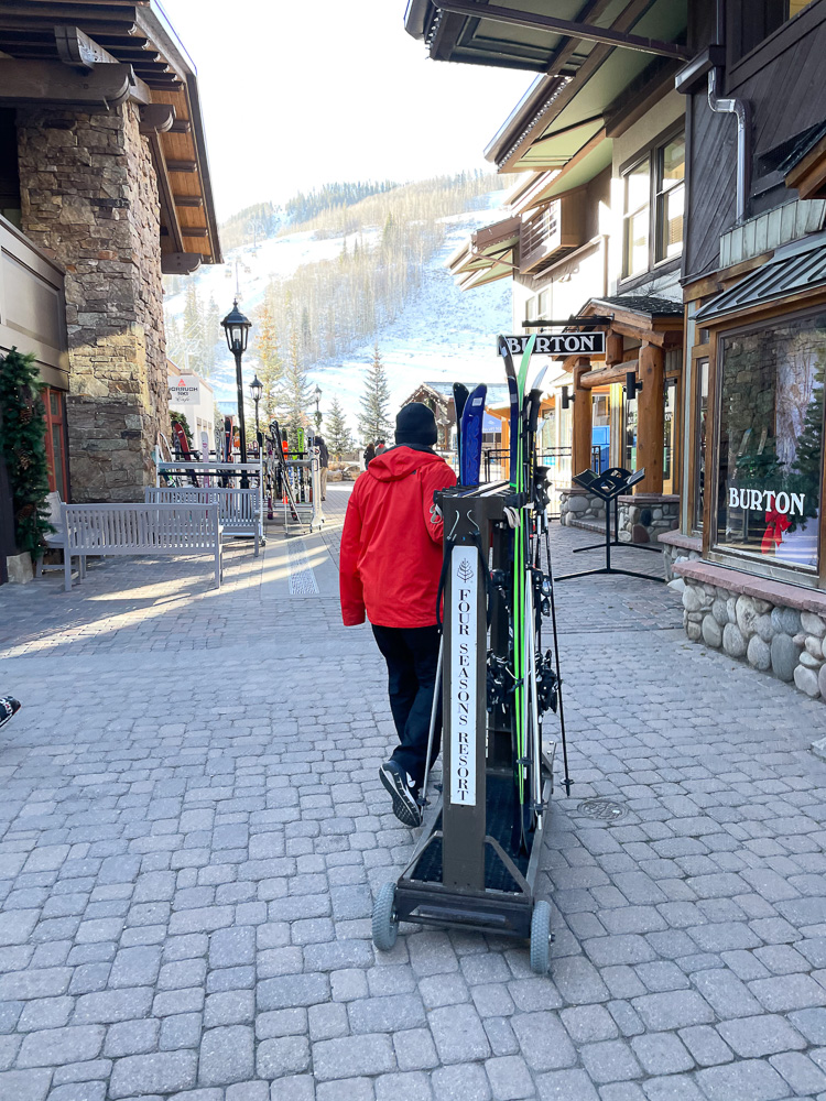 skis being brought to gondola by four seasons vail ski concierge