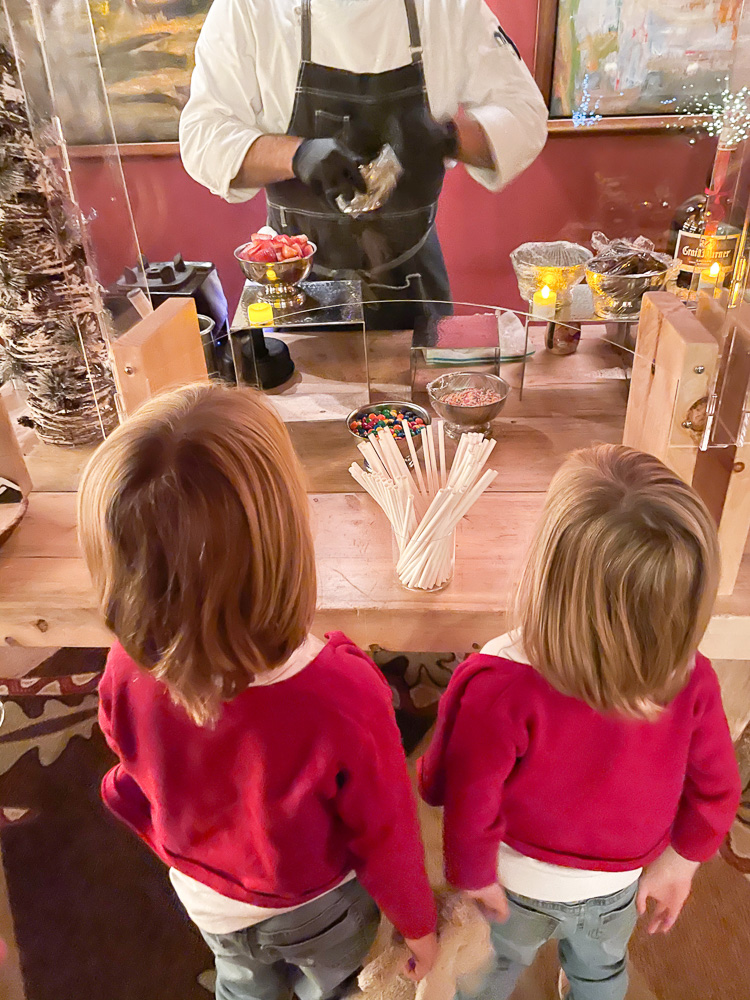 two boys watching chef make their milkshakes at four seasons vail