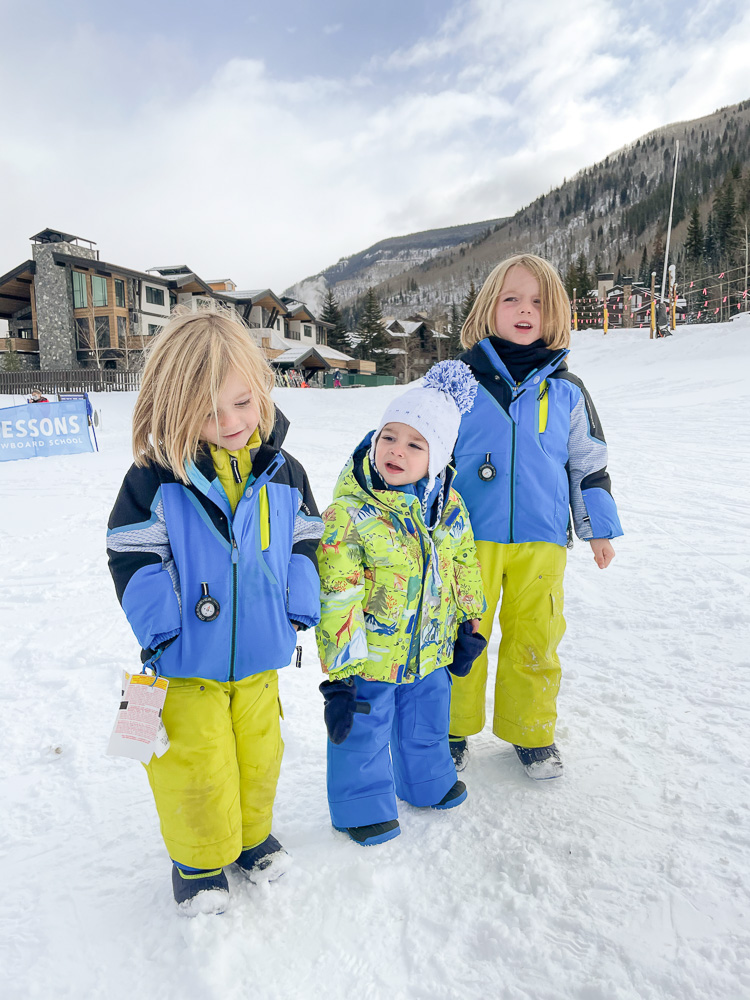 three brothers all bundled up for skiing