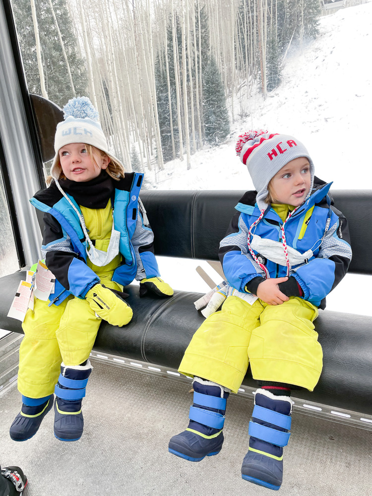 two small boys riding gondola vail