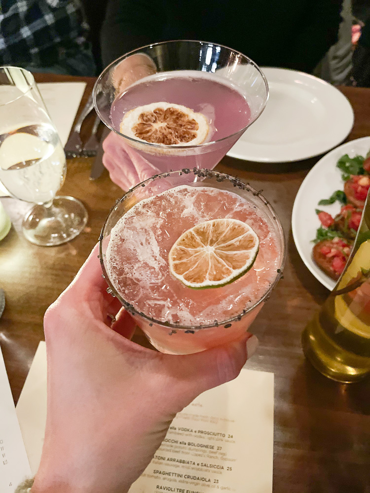 toasting with pink cocktails