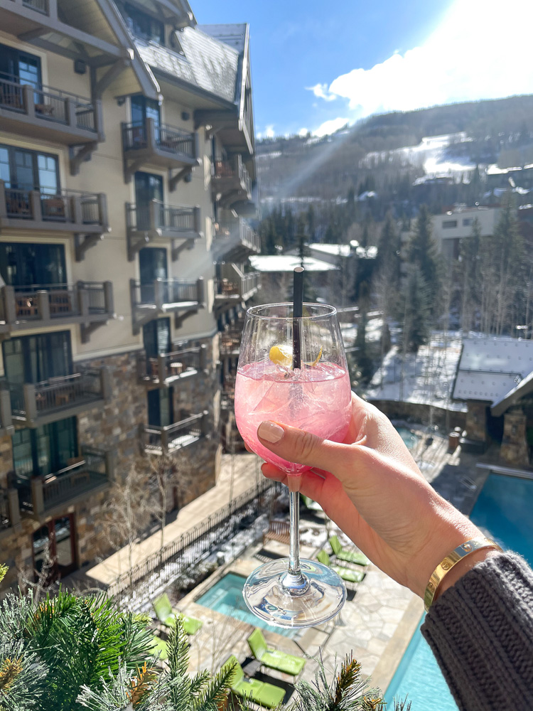 pink cocktail on balcony at four seasons vail