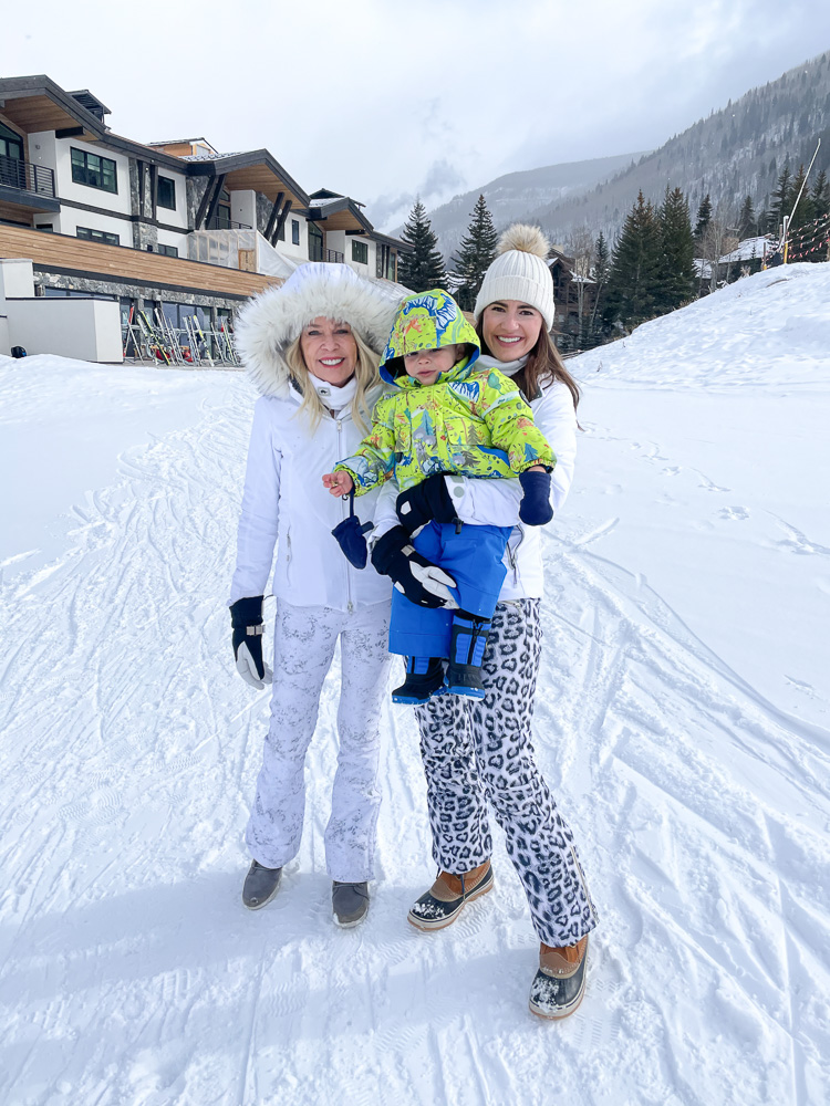 two women in ski wear with baby boy in ski wear